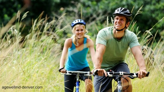 couple riding mountain bikes, hormone health